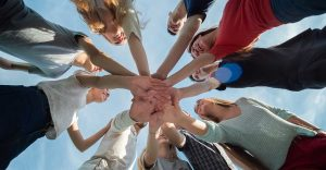 group all touching hands